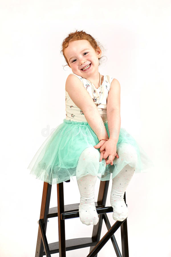 Little Girl Fashion Model in Green Dress. Fashion little girl in green dress, in catwalk model pose, stock photo. Image 09 royalty free stock photo