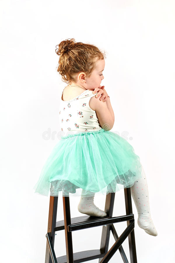 Little Girl Fashion Model in Green Dress. Fashion little girl in green dress, in catwalk model pose, stock photo. Image 12 royalty free stock photography