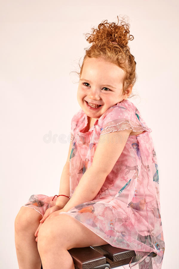 Little Girl Fashion Model in Rose Dress. Fashion little girl in rose dress, in catwalk model pose, stock photo royalty free stock photo