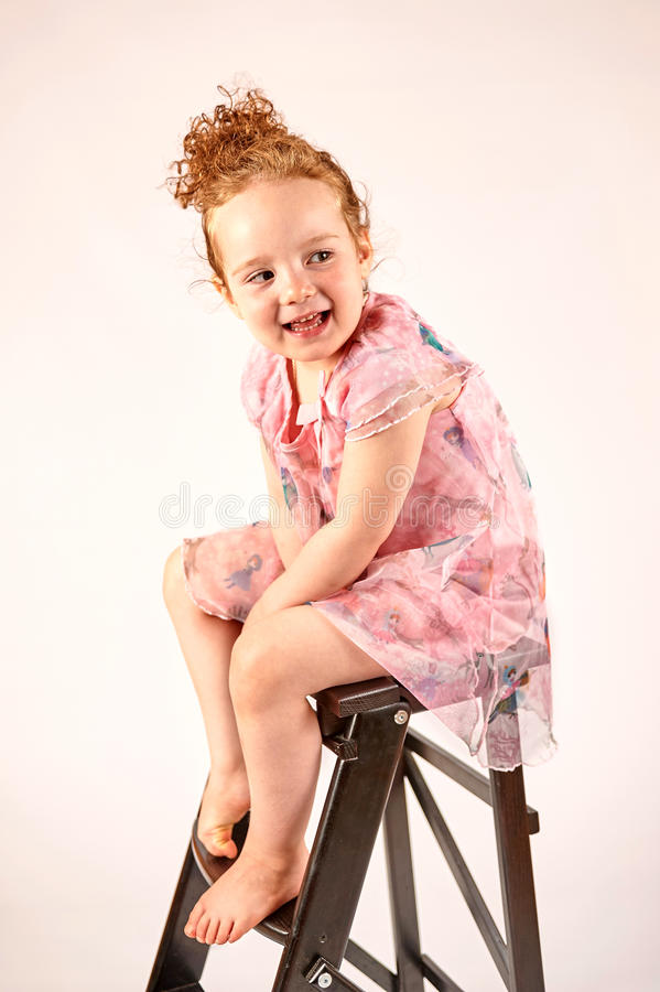 Little Girl Fashion Model in Rose Dress. Fashion little girl in rose dress, in catwalk model pose, stock photo royalty free stock photography