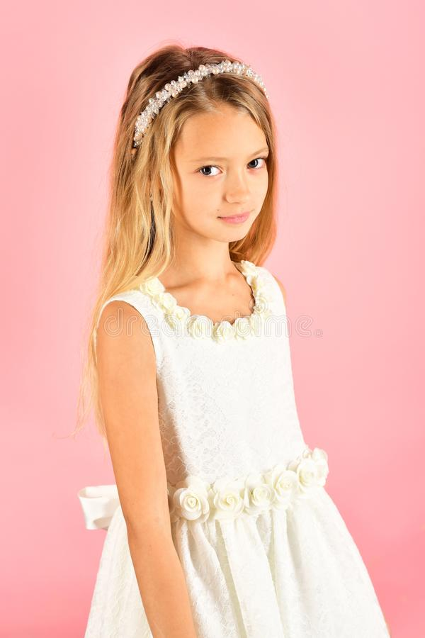 Little girl in fashionable dress, prom. Fashion model on pink background, beauty. Look, hairdresser, makeup. Child girl. In stylish glamour dress, elegance royalty free stock photos
