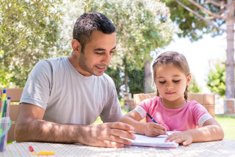 Little Girl And Father Drawing Pictures Together Outdoors In Sum royalty free stock images