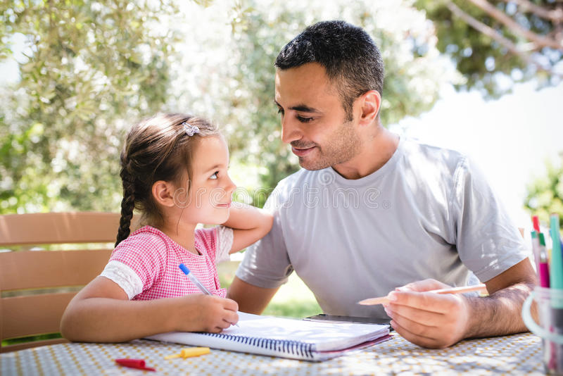 Little Girl And Father Drawing Pictures Together Outdoors In Sum royalty free stock photo
