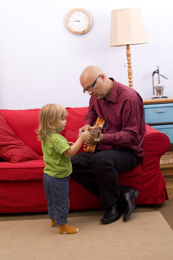 Download Little Girl With Father Play Electric Guitar Stock Image - Image: 11209071
