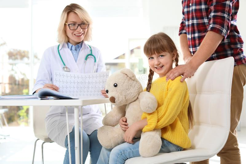 Little girl with father visiting children`s doctor royalty free stock image