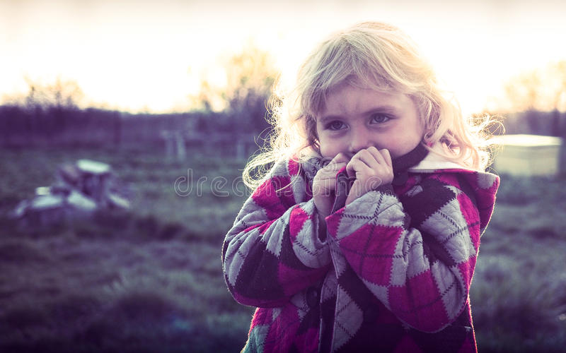 Little girl feeling cold. In the springtime royalty free stock photography
