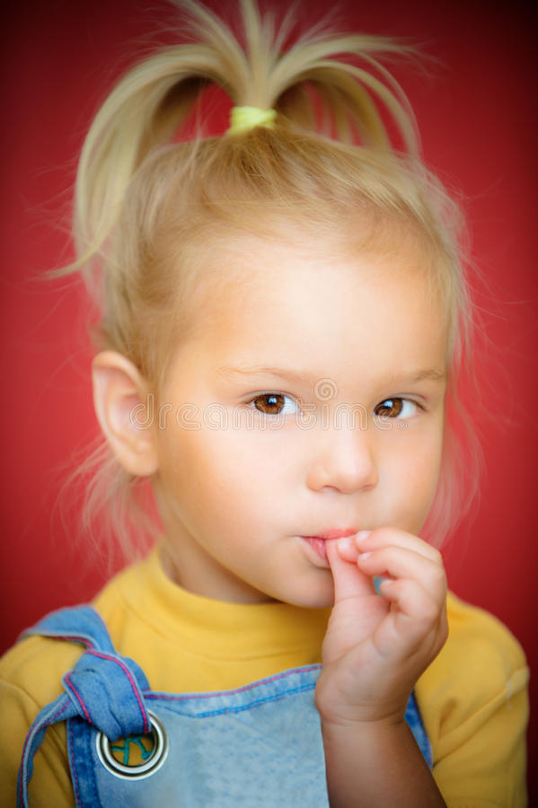 Little Girl With Finger On Mouth Stock Photo - Image 42437625-8848