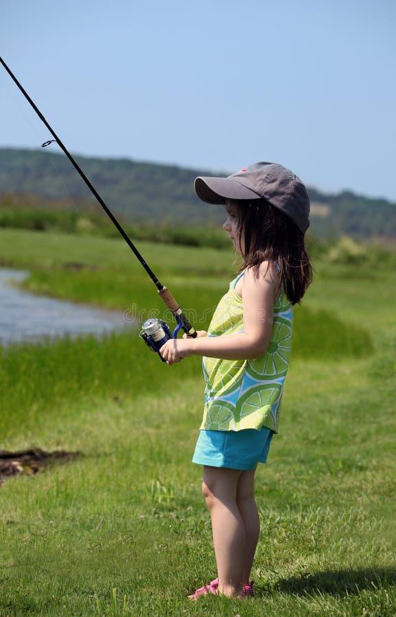 Little girl fishing royalty free stock photography