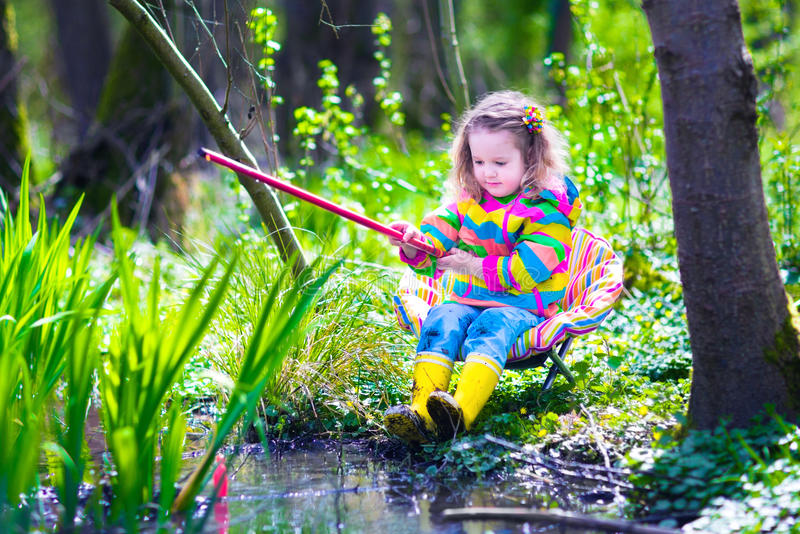 Little girl fishing in a forest stock image image of for Little girl fishing pole