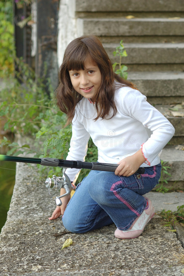 Little girl with fishing pole stock photography image for Little girl fishing pole