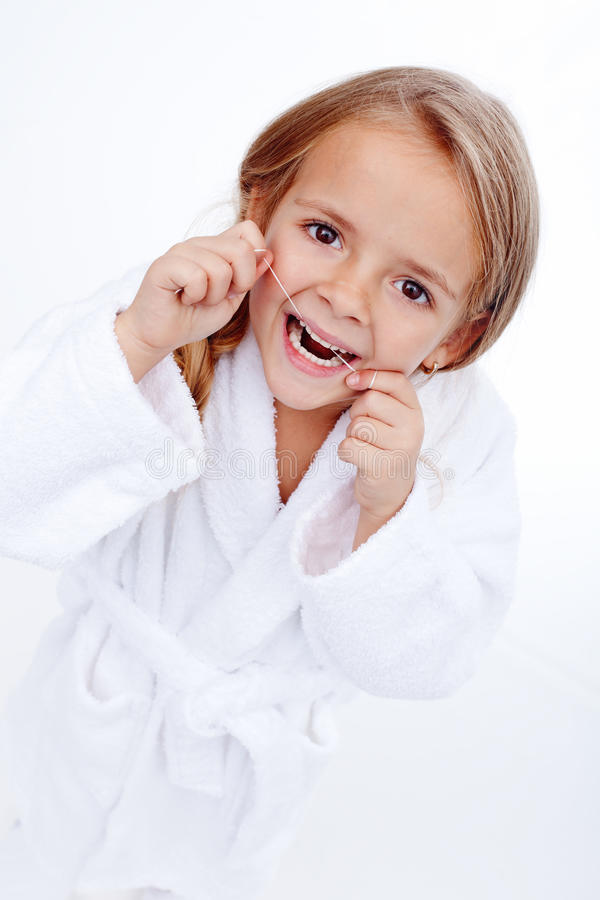 Little girl flossing royalty free stock photography
