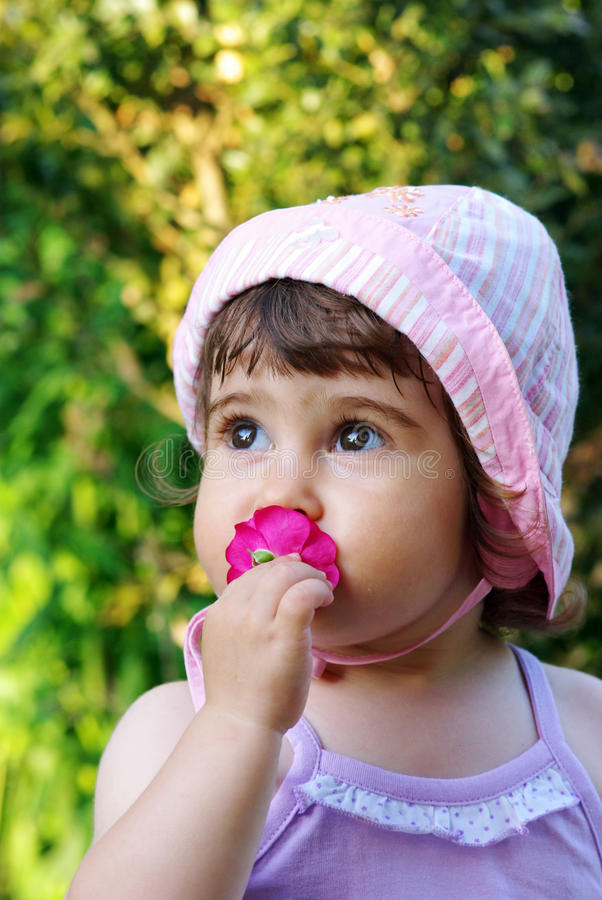 Little girl with flower stock photo