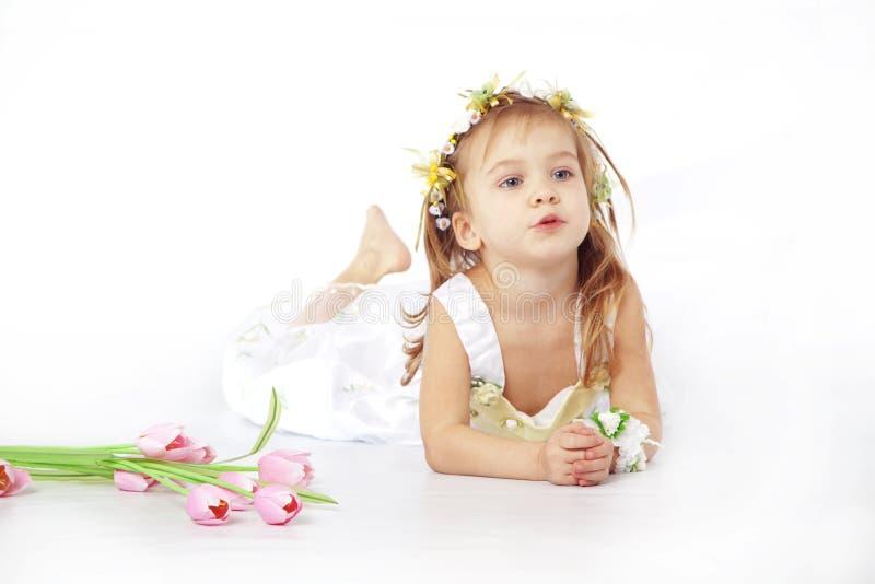 Little girl in flower dress stock photo