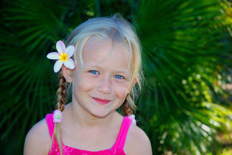 Little girl with flower in hair royalty free stock photos