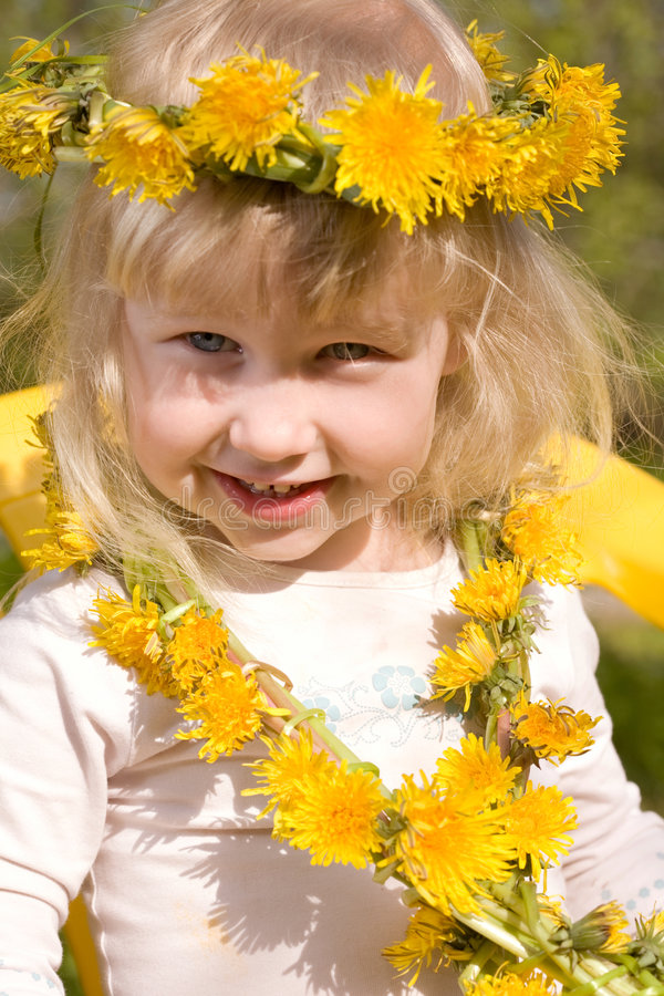 Little girl in flower wreath royalty free stock photo