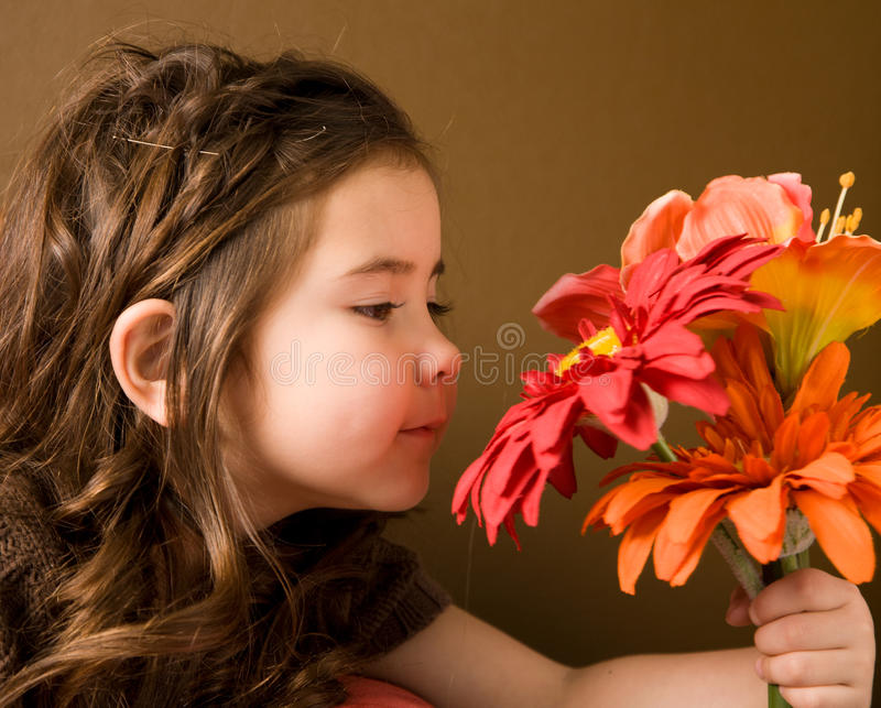 Little girl with flowers royalty free stock image