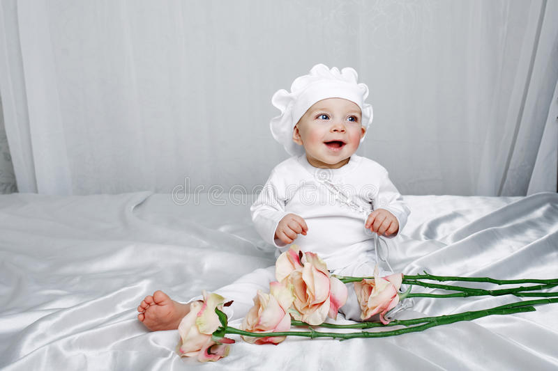Little Girl And Flowers Stock Images