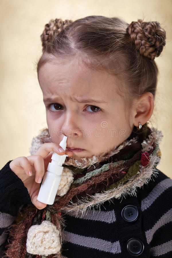 Download Little Girl With The Flu Using Nasal Spray Stock Image - Image: 29812783