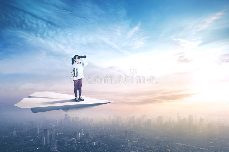 Little girl flying with paper plane stock photography