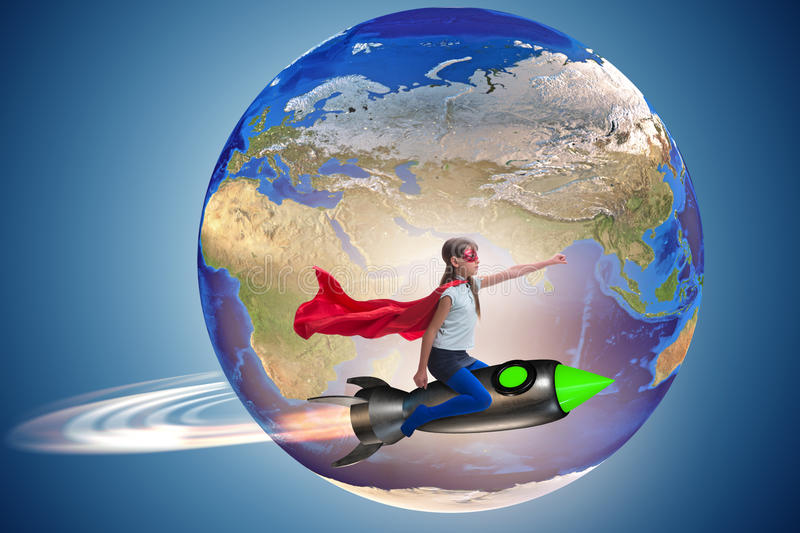 The little girl flying rocket in superhero concept. Little girl flying rocket in superhero concept royalty free stock images