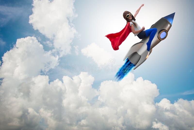 The little girl flying rocket in superhero concept. Little girl flying rocket in superhero concept royalty free stock photos
