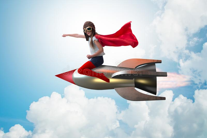 Little girl flying rocket in superhero concept. The little girl flying rocket in superhero concept stock photography