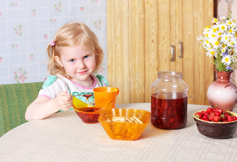 Little girl with food stock photo