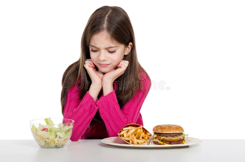 Little girl with food royalty free stock images