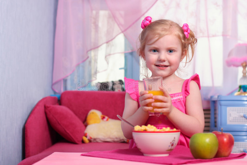 Little girl with food stock photography