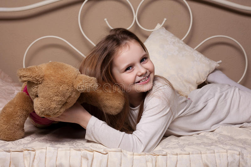 Little girl fooling in the studio royalty free stock photography