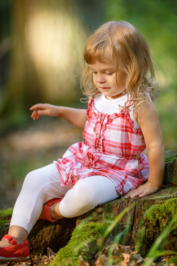 Download Little girl in the forest stock image. Image of child - 38418285