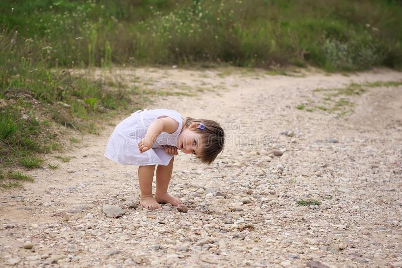 Little girl found debris on the road stock photo
