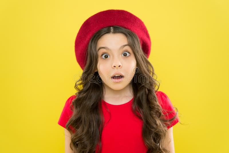 Little girl in french style hat. summer fashion and beauty. childhood. hairdresser salon. parisian child on yellow. Background. surprised girl with long curly stock photos
