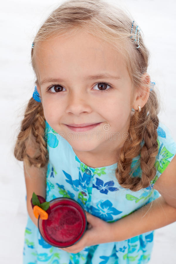 Download Little Girl With Fresh Juice - Top View Stock Photo - Image: 21922470