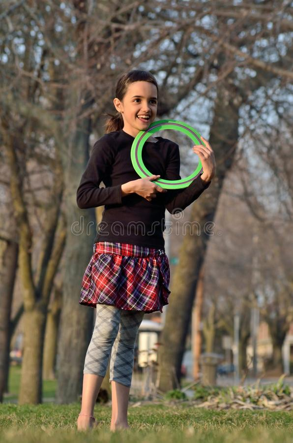 Little Girl with Frisbee royalty free stock images