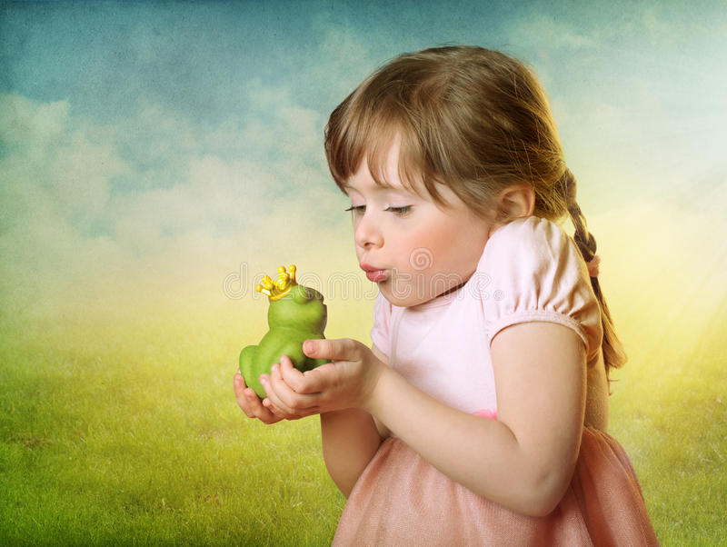 Little girl with a frog prince stock photography