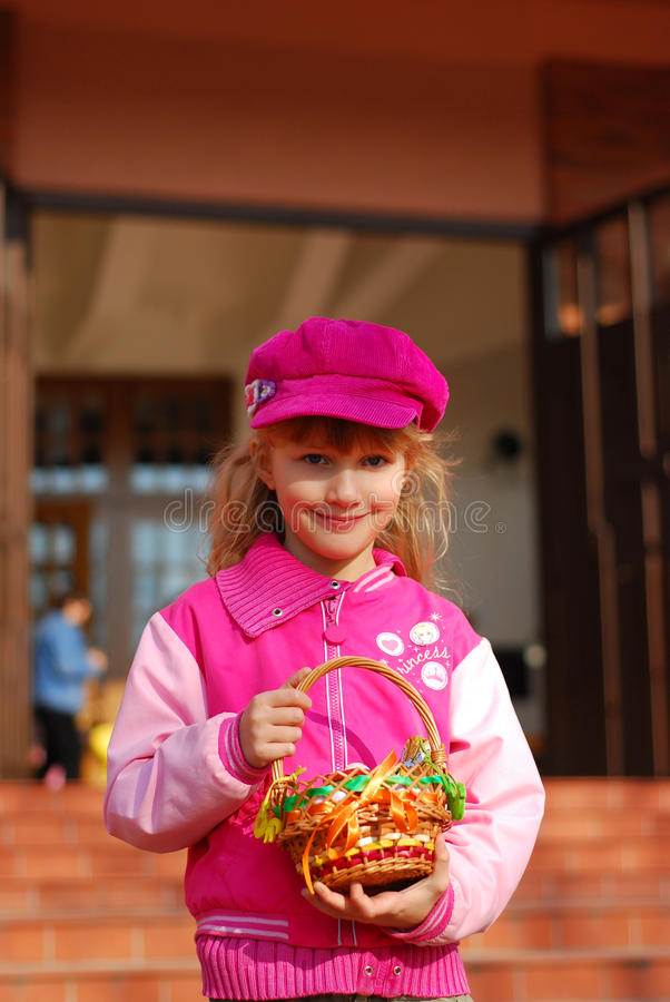 Download Little Girl In Front Of Church In Easter Time Stock Photo - Image of little, celebration: 12486810