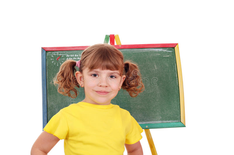 Little girl in front of a drawing board