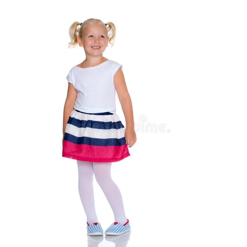 The little girl is full-length. stock image