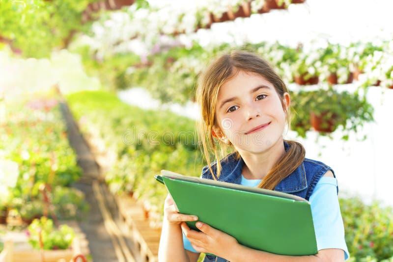 little girl in the garden flowers stock photos