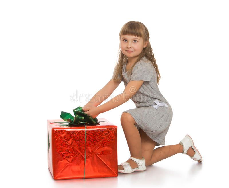 Little girl with a gift stock images