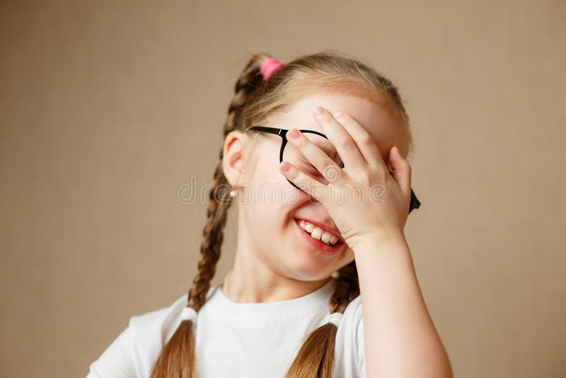 Beautiful little girl wearing glasses stock photos