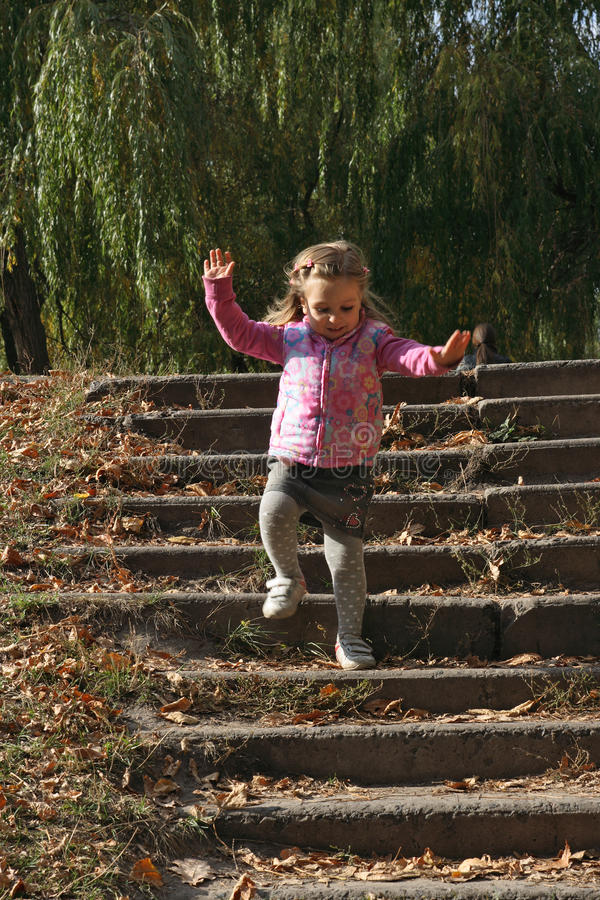 Little girl going down the steps royalty free stock photos