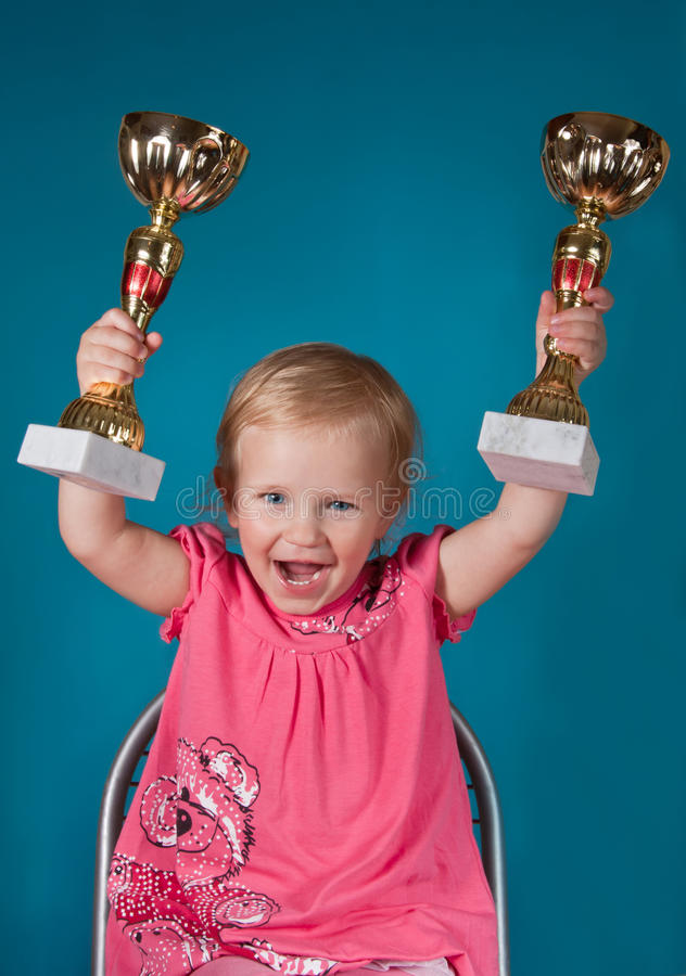 Download Little Girl With Golden Trophies Stock Image - Image: 42118663