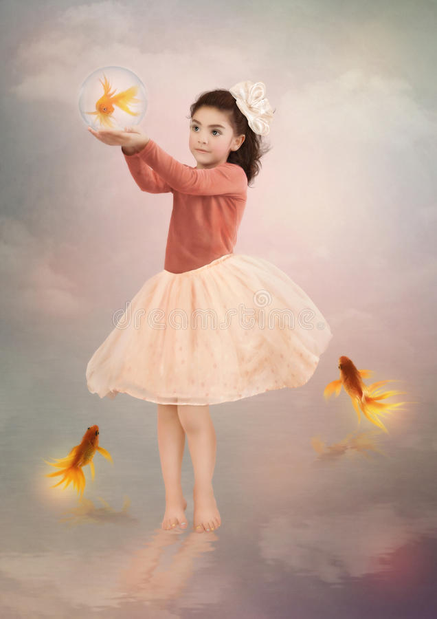 Little girl and goldfish stock image