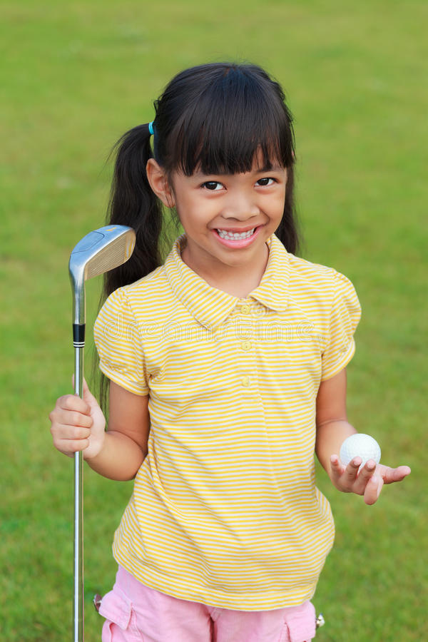Little girl at golf club stock images