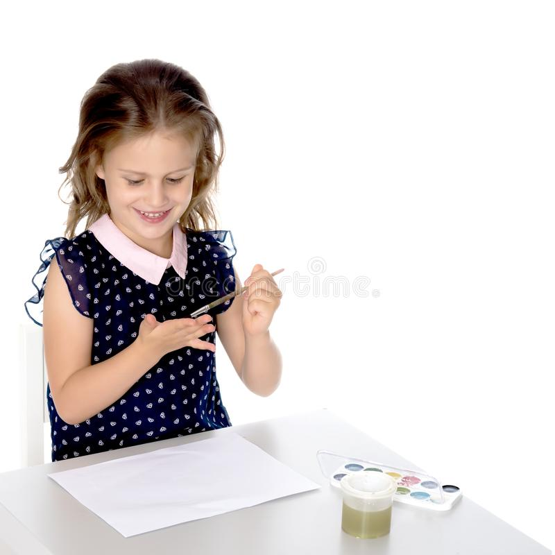 The little girl got dirty with the paints. royalty free stock images