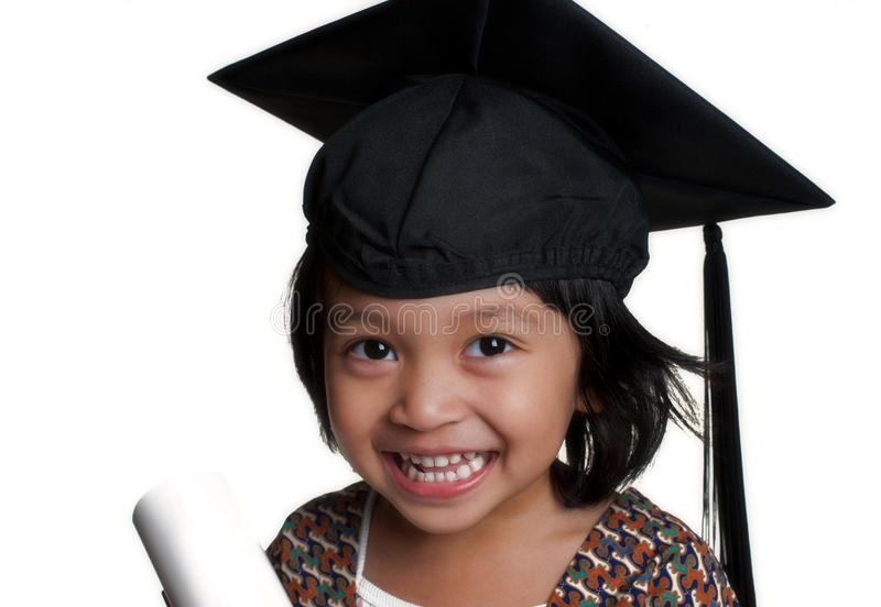 Little girl with graduation cap. The photo of little girl with graduation cap royalty free stock image