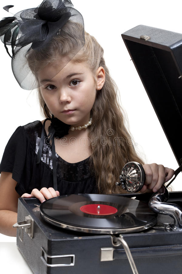 Little girl with gramophone. Isolated on white royalty free stock images