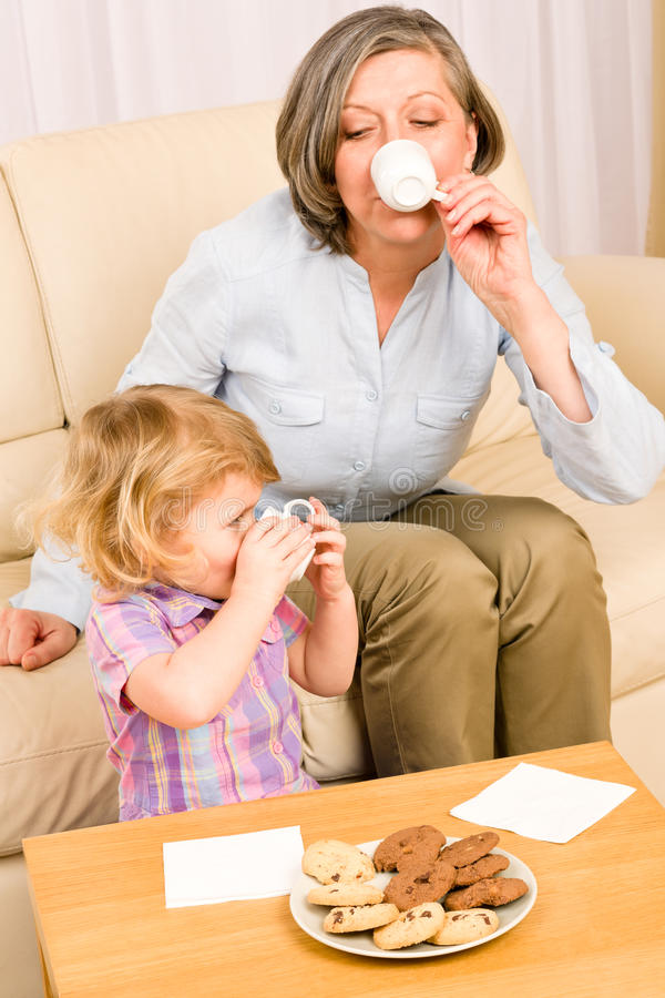Download Little Girl With Grandmother Eat Cookies Stock Photo - Image of drink, childhood: 23458842
